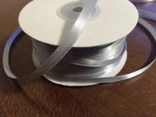 Szatén szalag, szín: ezüst, szélesség: 6mm, 1 tekercs: 100m, egységár: 12,0 Ft/méter*