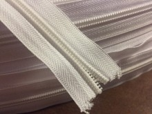 Zipper (endless), color: white, 1 roll: 50m, width of the spiral: 6mm, unitprice: 39,0 Ft/meter*
